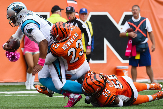 Oct 12, 2014; Cincinnati, OH, USA; Carolina Panthers quarterback Cam Newton (1) runs with the ball to score a touchdown as Cincinnati Bengals outside linebacker Vontaze Burfict (55) defends during ...