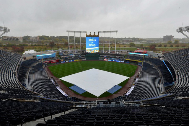 Oct 13, 2014; Kansas City, MO, USA; A general view as a tarp covers the field before game three of the 2014 ALCS playoff baseball game between the Baltimore Orioles and Kansas City Royals at Kauff ...
