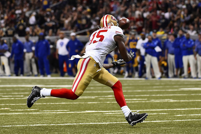 Oct 13, 2014; St. Louis, MO, USA; San Francisco 49ers wide receiver Michael Crabtree (15) catches a pass for a touchdown against the St. Louis Rams during the second half at the Edward Jones Dome. ...