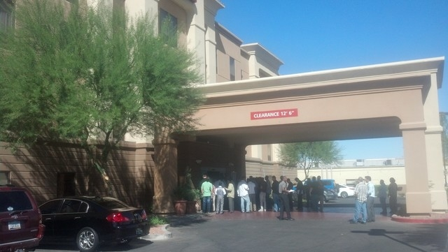 People attending an informational meeting about the Uber ride-sharing service await entry to the room at the Hampton Inn on Eastern Avenue on Wednesday, Oct. 15, 2014. (Richard N. Velotta/Las Vega ...