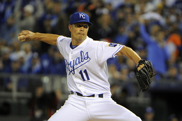 Kansas City Royals starting pitcher Jeremy Guthrie throws a pitch against the Baltimore Orioles during the first inning in game three of the 2014 ALCS playoff baseball game at Kauffman Stadium, Tu ...
