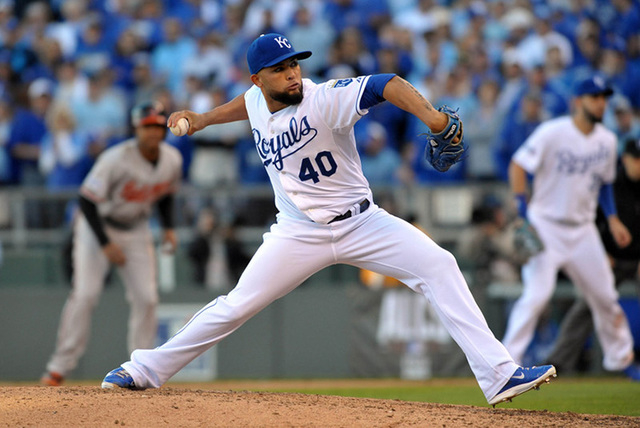 Oct 15, 2014; Kansas City, MO, USA; Kansas City Royals relief pitcher Kelvin Herrera throws a pitch against the Baltimore Orioles during the sixth inning in game four of the 2014 ALCS playoff base ...