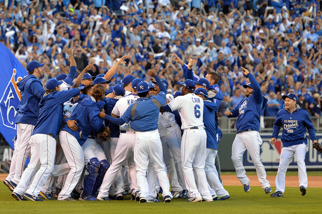 Oct 15, 2014; Kansas City, MO, USA; Kansas City Royals players celebrate on the field after game four of the 2014 ALCS playoff baseball game against the Baltimore Orioles at Kauffman Stadium. The  ...