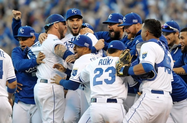 Oct 15, 2014; Kansas City, MO, USA; Kansas City Royals players celebrate on the field after defeating the Baltimore Orioles in game four of the 2014 ALCS playoff baseball game at Kauffman Stadium. ...