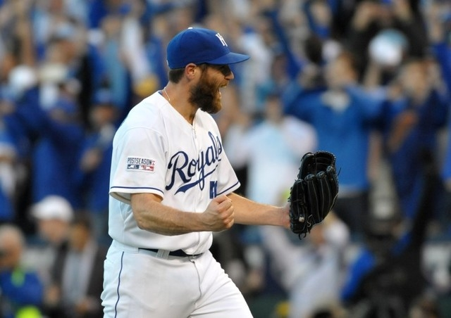 Oct 15, 2014; Kansas City, MO, USA; Kansas City Royals relief pitcher Greg Holland celebrates after defeating the Baltimore Orioles in game four of the 2014 ALCS playoff baseball game at Kauffman  ...