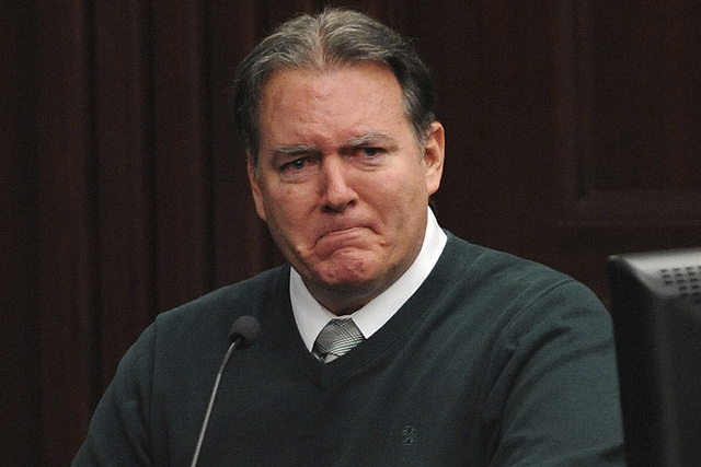 Defendant Michael Dunn reacts on the stand during testimony in his own defense during his murder trial in Duval County Courthouse in Jacksonville, Florida, in this file photo taken February 11, 20 ...