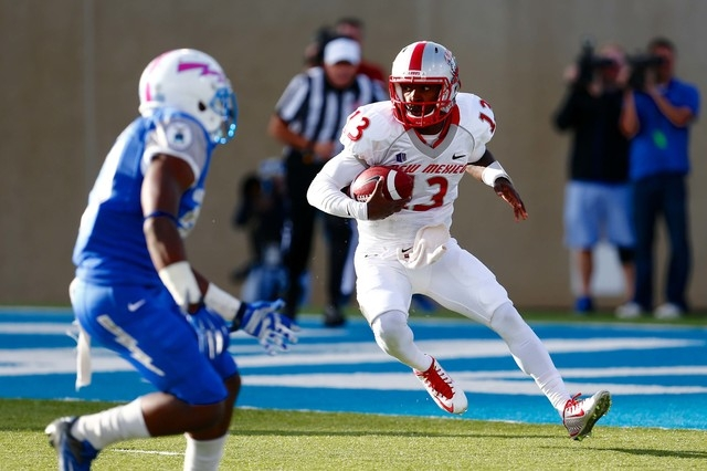 New Mexico runs the triple option. Quarterback Lamar Jordan (13) runs the ball against Air Force on Oct. 18, 2014. (Isaiah J. Downing-USA TODAY Sports)