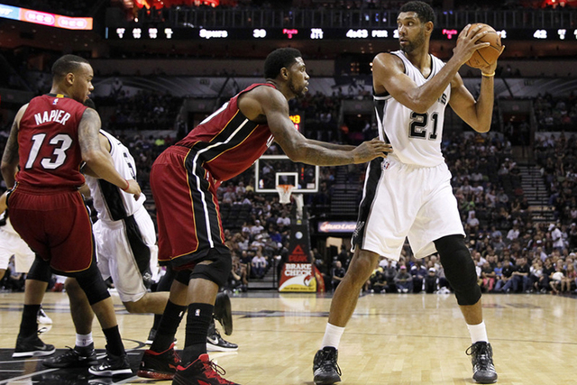 Oct 18, 2014; San Antonio, TX, USA; San Antonio Spurs power forward Tim Duncan (21) is defended by Miami Heat power forward Udonis Haslem (left) during the first half at AT&T Center. (Soobum Im-US ...