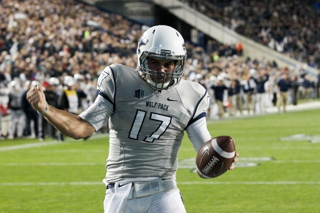 UNR quarterback Cody Fajardo (17) celebrates after scoring a touchdown against Brigham Young at Lavell Edwards Stadium in Provo, Utah, on Oct. 18, 2014. The Wolf Pack beat the Cougars, 42-35. (Chr ...