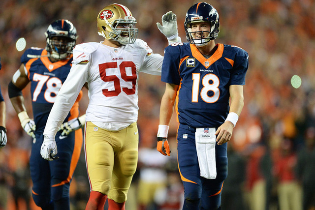 Oct 19, 2014; Denver, CO, USA; San Francisco 49ers linebacker Aaron Lynch (59) congratulates Denver Broncos quarterback Peyton Manning (18) after his 509th touchdown pass in the second quarter at  ...