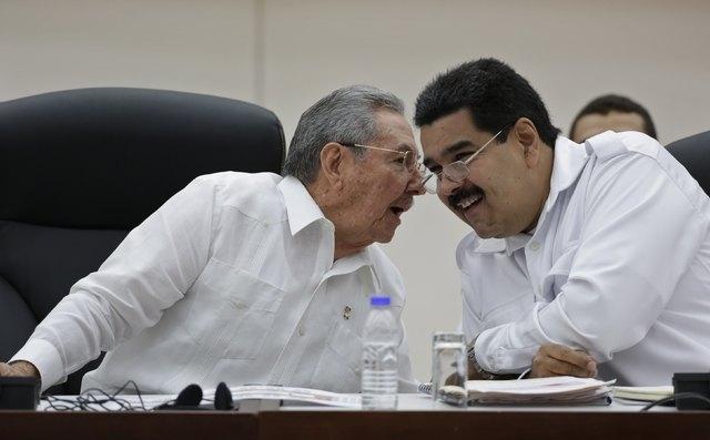 Cuba's President Raul Castro, left, talks to his Venezuelan counterpart Nicolas Maduro during the opening ceremony of the ALBA-TCP Extraordinary Ebola summit in Havana, Monday, Oct. 20, 2014. (Reu ...