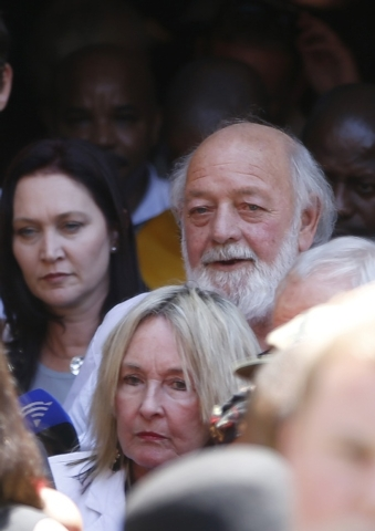 June and Barry Steenkamp, parents of Reeva Steenkamp, leave the court after the sentencing of South African Olympic and Paralympic sprinter Oscar Pistorius in Pretoria, Tuesday, Oct. 21, 2014. Pis ...