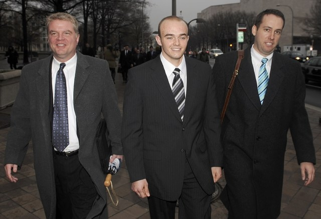 Blackwater Worldwide security guard Nick Slatten (C) leaves the federal courthouse with attorneys after being arraigned on manslaughter charges for allegedly killing 14 unarmed civilians and wound ...