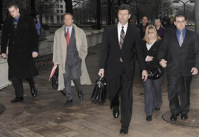 Blackwater Worldwide security guards Evan Liberty (L) and Dustin Heard (R) leave the federal courthouse with their legal team and supporters after being arraigned with three fellow Blackwater guar ...