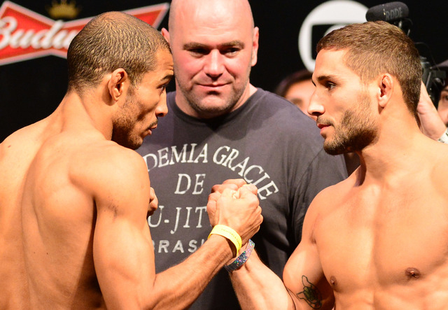 Jose Aldo (left) squares off with Chad Mendes during weigh-ins for UFC 179 Oct. 24 in Rio de Janeiro. (Jason Silva-USA TODAY Sports)