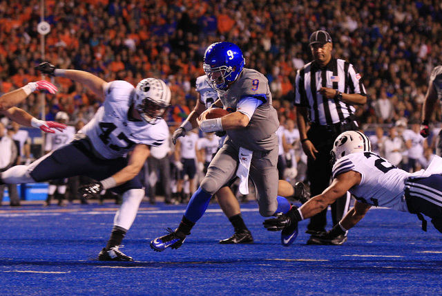 Boise State quarterback Grant Hedrick (9) scores a touchdown during the first half against Brigham Young on Oct 24, 2014. (Brian Losness-USA TODAY Sports)