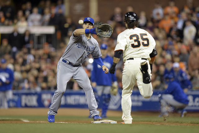Oct 26, 2014; San Francisco, CA, USA; San Francisco Giants shortstop Brandon Crawford (35) is forced out by Kansas City Royals first baseman Eric Hosmer (35) in the sixth inning during game five o ...