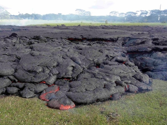 The lava flow from the Kilauea Volcano is seen in a U.S. Geological Survey image taken near the village of Pahoa, Hawaii, Sunday, Oct. 26, 2014. (Reuters/U.S. Geological Survey handout)