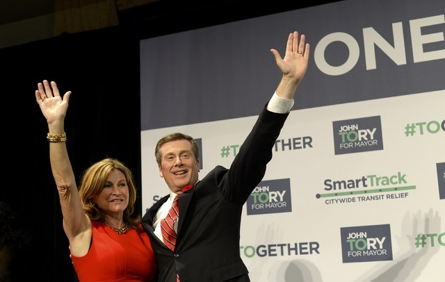 John Tory waves with his wife, Barbara Hackett, after being elected as mayor in Toronto, Monday, Oct. 27, 2014. (Reuters/Aaron Harris)