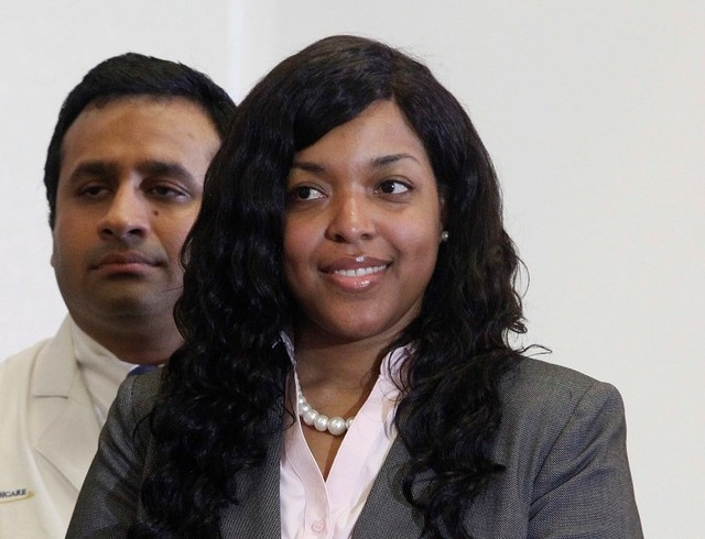Amber Vinson speaks before her release from Emory University Hospital in Atlanta, Tuesday, Oct. 28, 2014. Vinson  was the second of two American nurses who became infected with Ebola while treatin ...