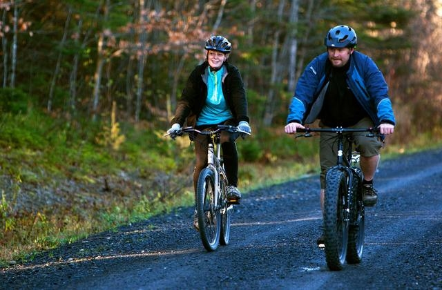 Kaci Hickox and boyfriend Ted Wilbur go for a bike ride in Fort Kent, Maine, on Thursday, Oct. 30, 2014. A Maine judge issued a temporary order on Friday, Oct. 31, enforcing a quarantine after Hic ...