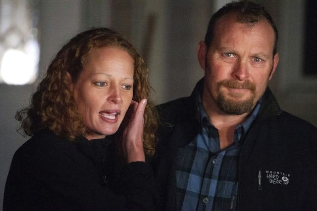 Nurse Kaci Hickox and her boyfriend, Ted Wilbur, address the media outside their home in Fort Kent, Maine, Wednesday, Oct. 29, 2014. A Maine judge issued a temporary order on Friday, Oct. 31, enfo ...