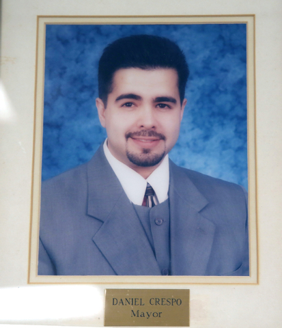 An official portrait of Daniel Crespo, the mayor of the City of Bell Gardens hangs at the city's police station in Bell Gardens, Calif., Tuesday, Sept. 30, 2014. (AP Photo/Nick Ut)