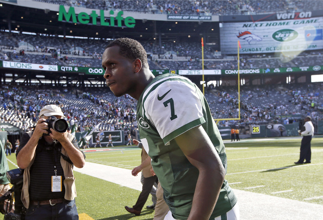 In this photo taken on Sunday, Sept. 28, 2014, New York Jets quarterback Geno Smith walks off the field after losing 24-17 to the Detroit Lions during an NFL football game in East Rutherford, N.J. ...