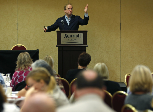 Dr. Jon Grant talks about gambling and other addictive disorders during the New York Council on Problem Gambling's annual conference on Thursday, Oct. 2, 2014, in Albany, N.Y. New York has slashed ...