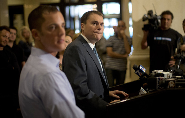 FILE - In this Wednesday, Nov. 7, 2012 file photo, San Diego city councilman Carl DeMaio, Republican candidate for mayor, center, gives a news conference alongside his partner Jonathan Hale, left, ...