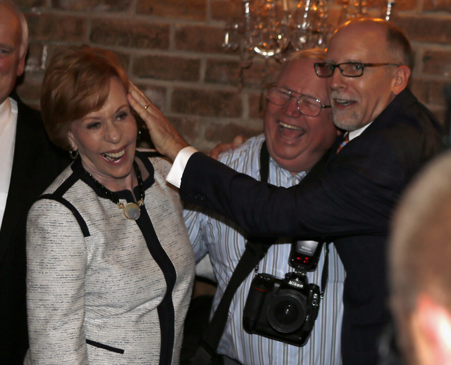 Carol Burnett, left, gets a friendly shove by Jeff Tobin, the Jimmy Stewart Museum President, as they laugh with photographer Jim Wakefield during a photo opportunity before the banquet where Burn ...