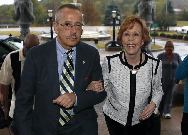 Carol Burnett, right, is escorted by Timothy Harley, the executive director of the Jimmy Stewart Museum, as she arrives at the Chestnut Ridge Resort for a banquet to receive the 2014 Harvey Award  ...