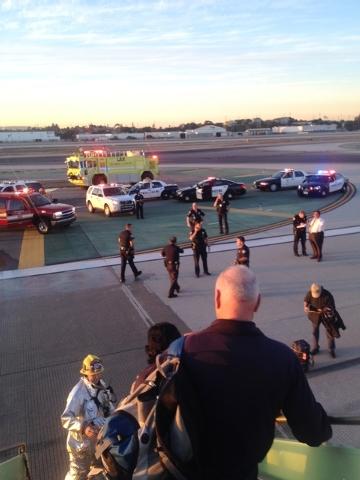 In this photo provided by Sara Seligman authorities work the scene at Los Angeles International Airport as passengers exit the plane after the Mexico City-bound Aeromexico jet hit its brakes after ...