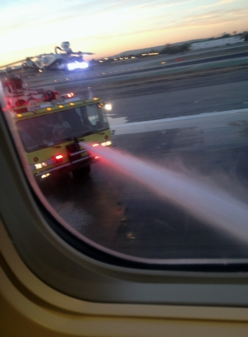 In this photo provided by Sara Seligman authorities work the scene at Los Angeles International Airport after a Mexico City-bound Aeromexico jet hit its brakes after the left landing gear collapse ...