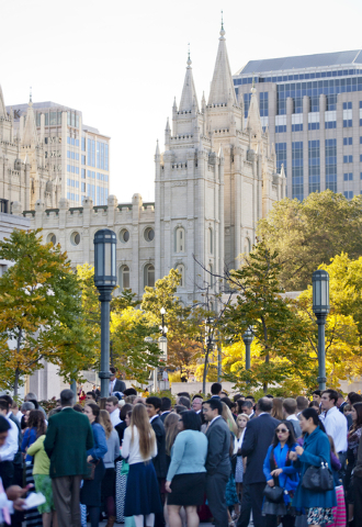 People wait in line outside of the The Church of Jesus Christ of Latter-day Saints' Conference Center with the Salt Lake Temple in the background to before the opening session of the two-day Mormo ...