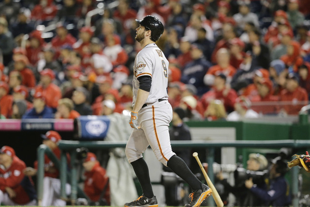 San Francisco Giants' Brandon Belt watches his solo home run in the 18th inning of Game 2 of baseball's NL Division Series against the Washington Nationals in Nationals Park, Saturday, Oct. 4, 201 ...
