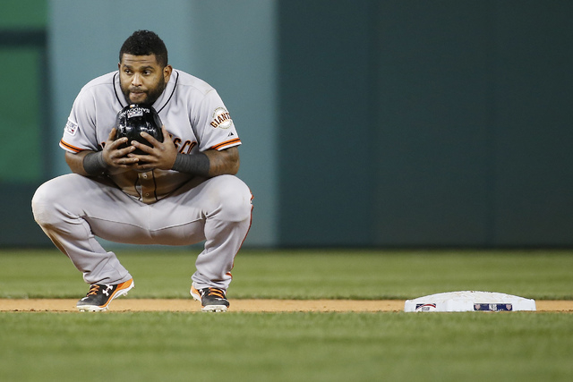 San Francisco Giants third baseman Pablo Sandoval (48) waits for the umpires to review the play at the plate in the ninth inning of Game 2 of baseball's NL Division Series against the Washington N ...