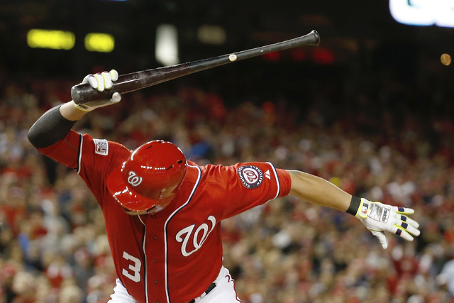 Washington Nationals' Asdrubal Cabrera reacts to the strike call in the tenth inning of Game 2 of baseball's NL Division Series against the San Francisco Giants in Nationals Park, Saturday, Oct. 4 ...
