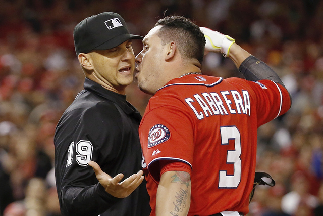 Washington Nationals' Asdrubal Cabrera argues a strike call with home plate umpire Vic Carapazza in the tenth inning of Game 2 of baseball's NL Division Series against the San Francisco Giants in  ...