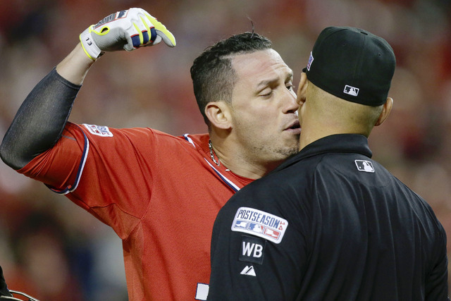 Washington Nationals' Asdrubal Cabrera argues his strike out call with home plate umpire Vic Carapazza in the tenth inning of Game 2 of baseball's NL Division Series against the San Francisco Gian ...