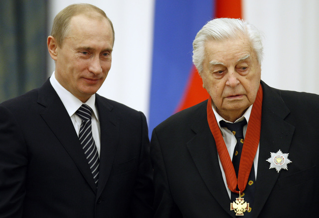 President Vladimir Putin poses for a photo with art director of the Taganka Theater Yuri Lyubimov during an awards ceremony at the Moscow Kremlin, in this Dec. 13, 2007 file photo. Lyubimov died S ...