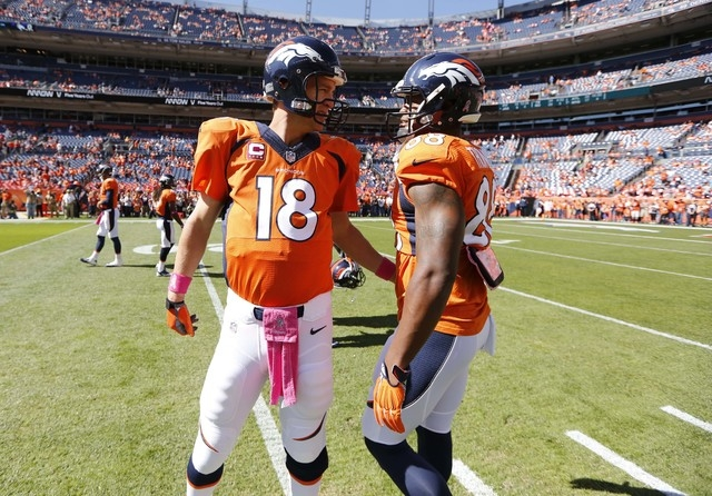 Denver Broncos quarterback Peyton Manning (18) talks with Demaryius Thomas (88) prior to an NFL football game against the Arizona Cardinals, Sunday, Oct. 5, 2014, in Denver. (AP Photo/Jack Dempsey)