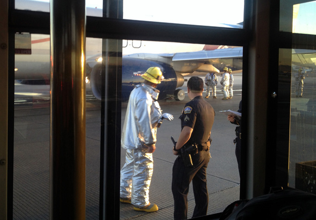 In this photo provided by Sara Seligman, authorities work on the tarmac of Los Angeles International Airport after a Mexico City-bound Aeromexico airplane's left landing gear collapsed while it wa ...