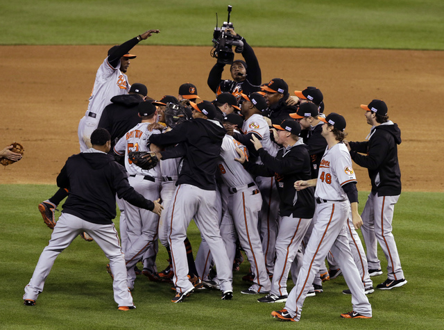 Baltimore Orioles players celebrate after defeating the Detroit Tigers, 2-1 in Game 3 of baseball's AL Division Series Sunday, Oct. 5, 2014, in Detroit. Baltimore won the series 3-0. (AP Photo/Dar ...