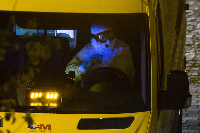 An ambulance transporting a Spanish nurse who believed to have contracted the ebola virus from a 69-year-old Spanish priest leaves Alcorcon Hospital in Madrid, Spain, Tuesday, Oct. 7, 2014. The nu ...