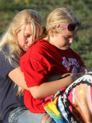 FILE- This undated file photo provided by the Stapleton family via the Traverse City Record-Eagle, shows Issy Stapleton, right, and her mother Kelli in Elberta, Mich. Kelli, facing charges of tryi ...