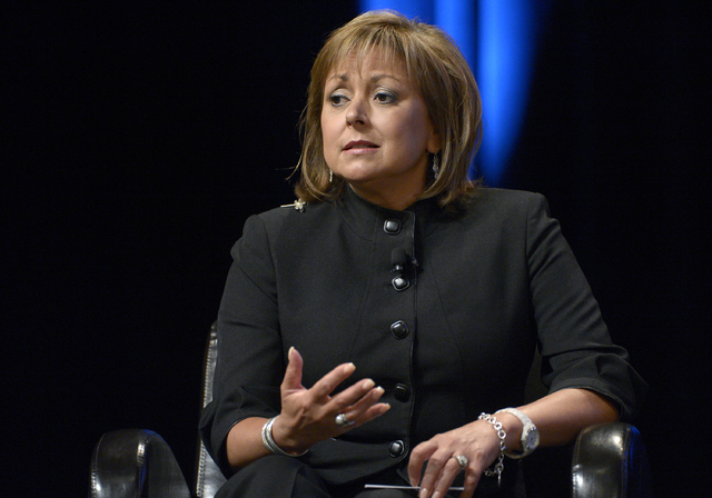 In this Aug. 22, 2013, file photo, Republican New Mexico Gov. Susana Martinez answers a question during a panel discussion at the Wal-Mart U.S. Manufacturing Summit in Orlando, Fla. Martinez and D ...