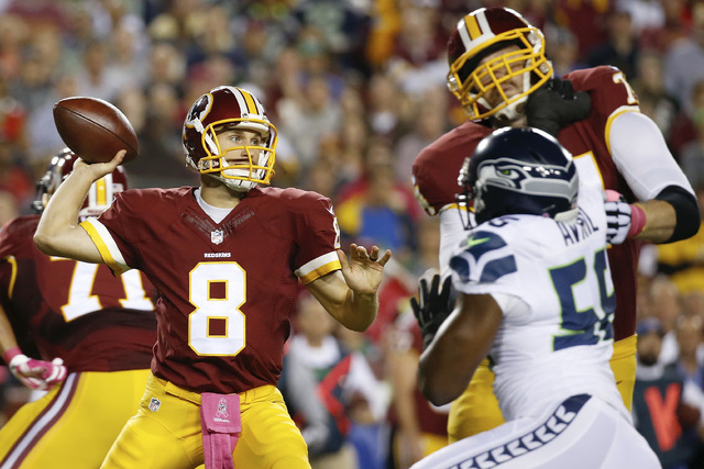 Washington Redskins quarterback Kirk Cousins (8) passes the ball during the first half of an NFL football game against the Seattle Seahawks in Landover, Md., Monday, Oct. 6, 2014. (AP Photo/Alex B ...