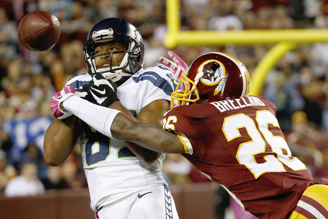 Washington Redskins strong safety Bashaud Breeland (26) breaks up a pass intended for Seattle Seahawks wide receiver Doug Baldwin (89) during the first half of an NFL football game in Landover, Md ...