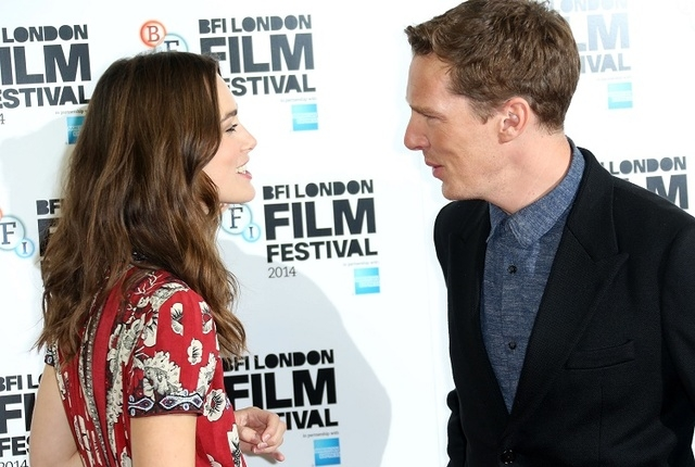 British actors Benedict Cumberbatch and Keira Knightley greet one another before they pose for photographers during the photo call of the film The Imitation Game, at the Corinthia Hotel in central ...